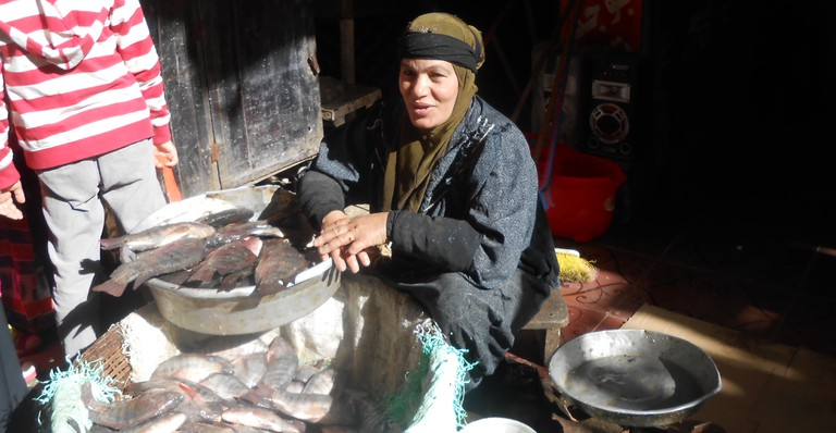 Woman selling fish at the market| © Mariam Ghorab