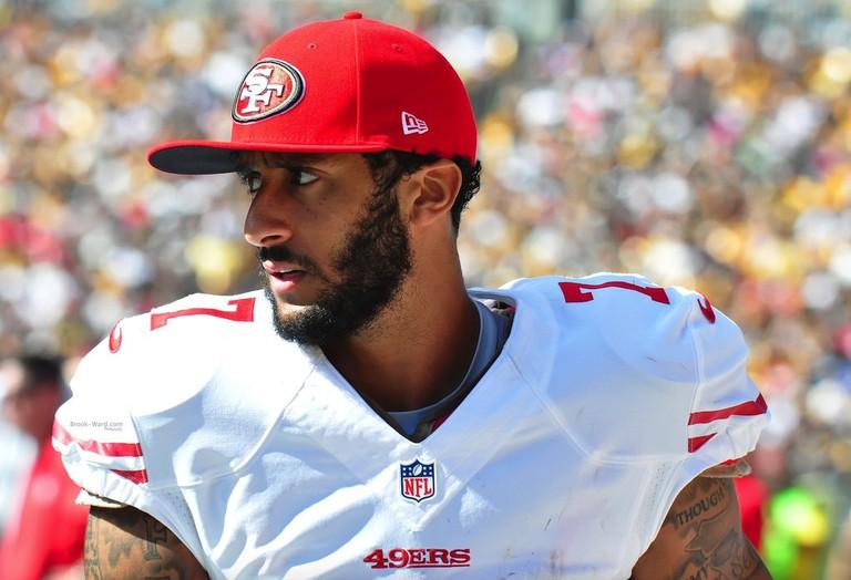 "Colin Kaepernick at the San Francisco 49ers   <a href=""https://www.flickr.com/photos/brookward/21586592316"" target=""_blank"" rel=""noopener"">© Brook Ward/Flickr</a>"