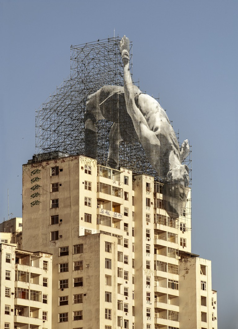 Installation on side of a building of a highjumper by French Street artist JR for Comité international Olympique, Rio de Janeiro, Brazil, 2016