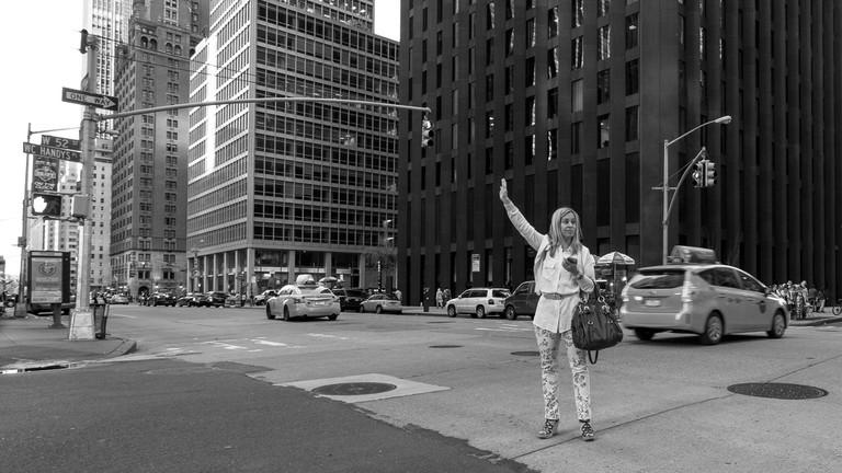 Hailing a taxicab | Dave Doe Flickr