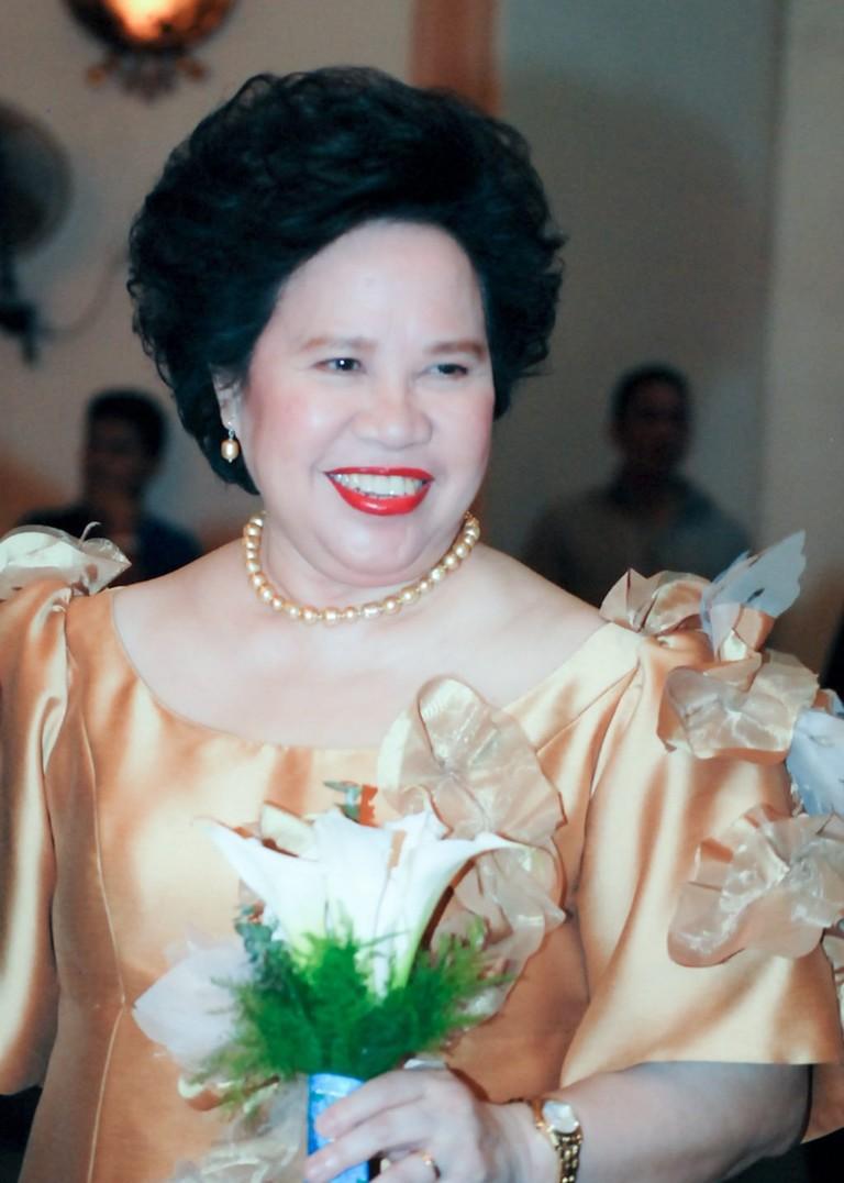 Miriam_beams_as_she_attends_a_wedding_as_a_sponsor