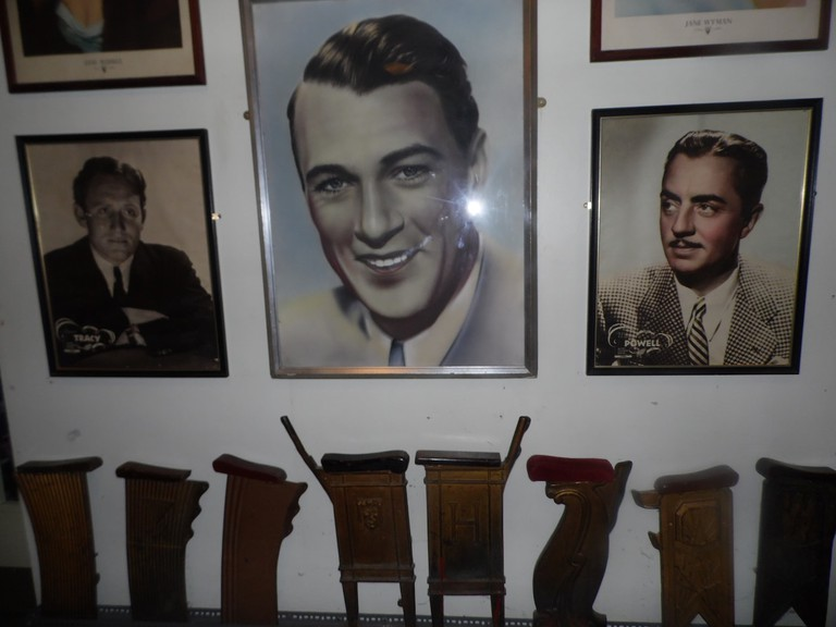 Vintage images of Spencer Tracy, Gary Cooper, and William Powell above man-made wooden cinema seats   © Lynsey Ford/Culture Trip