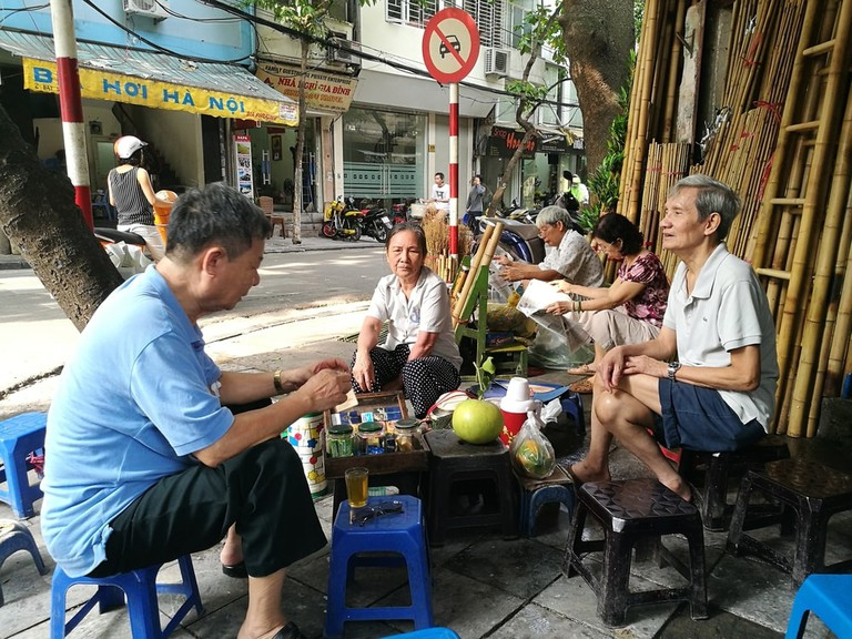 Street side tea and good company | © Asia Images/Shutterstock