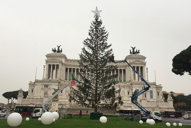 Workers had begun removing the tree's decorations on Tuesday morning, but were later ordered to put them back up as Spelacchio will stay in the piazza until Thursday 11 January | © Emma Law