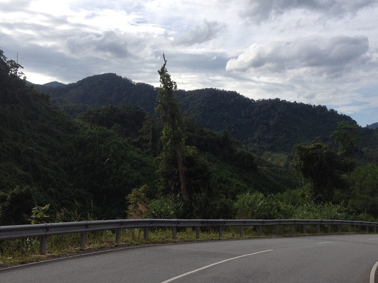 The Ho Chi Minh Road winding through the jungle