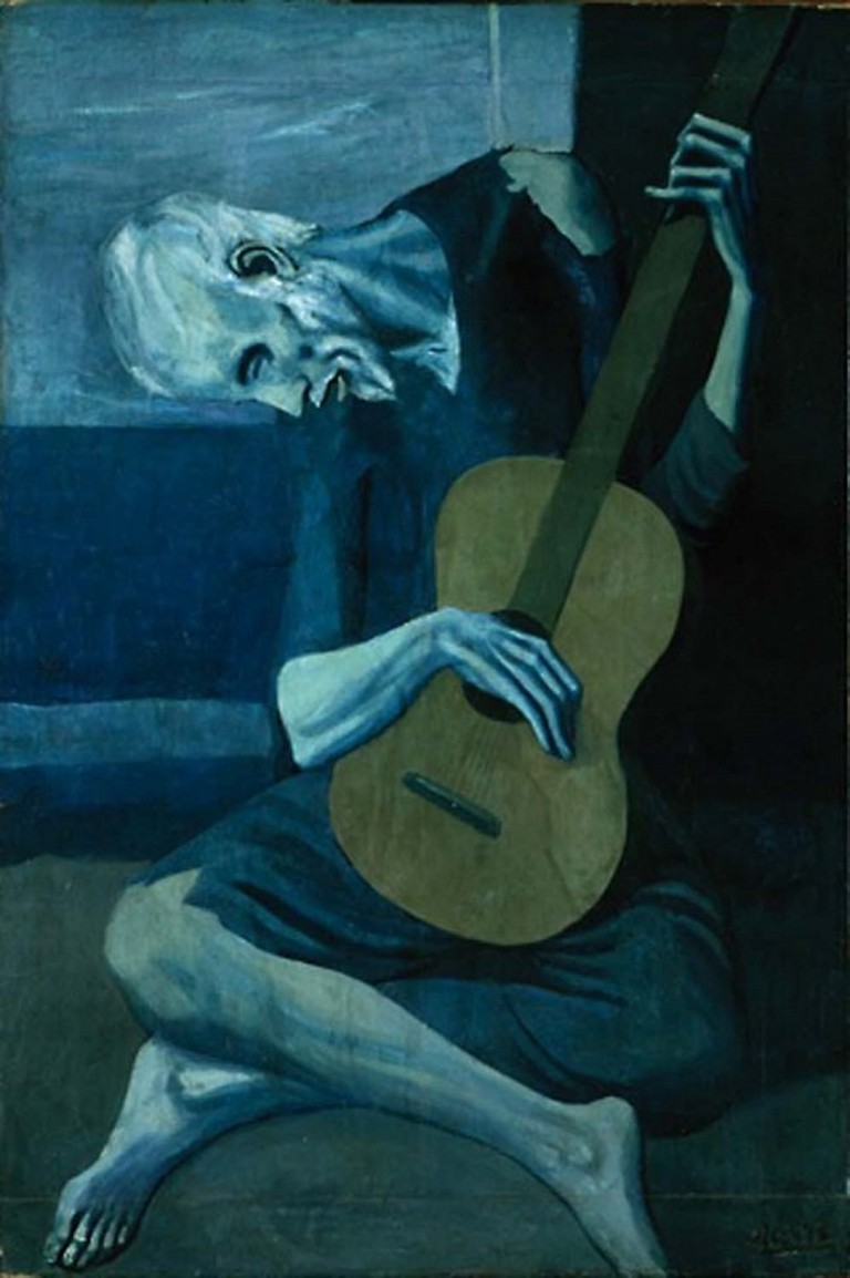 """<em>The Old Guitarist</em> by Pablo Picasso 