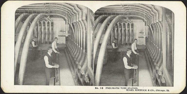 "There was also a pneumatic tube system in Chicago | <a href=""https://www.flickr.com/photos/boston_public_library/11237633933/in/photolist-ef5mqe-i82P4c-acmiMd-XomMav-cDMH29-pDcQ96-bwRAu-4A4HxB-iGjRNS-iEzcHy-4A922E-i82jXp-8DNhw9-iEyXv4-iCoASy-iGhJCw-9PXH7j-pDfhMw-4A4PCM-b55uSM-8wQxfv-pVLBnf-bfX5Bz-obYy8D-b55Aw6-8ij415-ouCy6w-9Lp8fn-8DNfDw-6wzQJt-pDfidm-dahhVt-8SQMne-eN4buW-8wQu6v-8DNfWm-rxNo3o-6g594a-8wRuVr-4A4MbZ-9j5LTH-9j9eH1-a42ese-oYR3y1-4A4N6P-b55FhX-ocT31t-otrBES-4A4Jw2-8wQt2X"" target=""_blank"" rel=""noopener"">© Boston Public Library/Flickr</a>"
