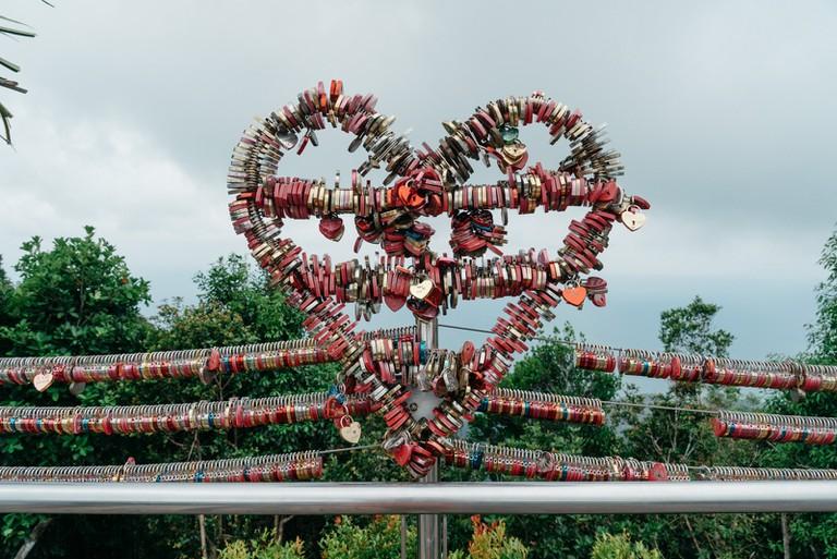 Love locks in a heart shape on the bridge   Irene Navarro / © Culture Trip