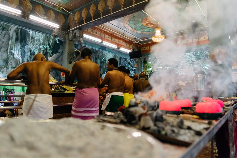 Preparing ashes that will be used to rub on the wounds of the devotees | Irene Navarro / © Culture Trip