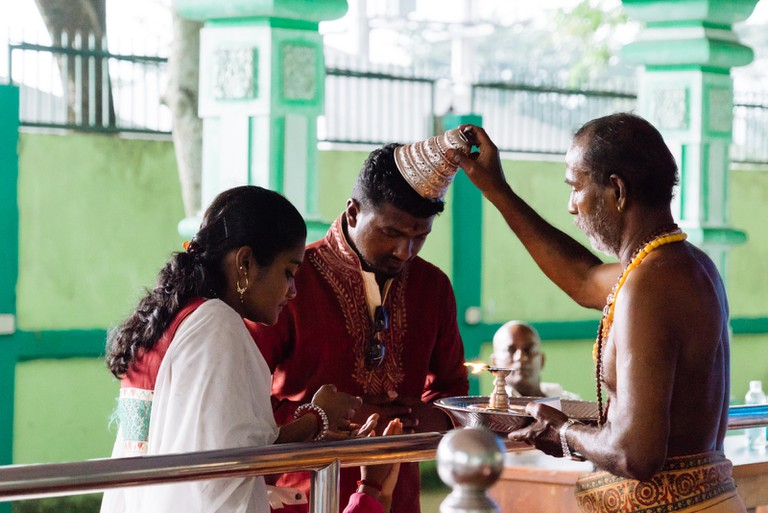 While others carry the Kavadi, some would come to get blessings from the priest | Irene Navarro / ©Culture Trip