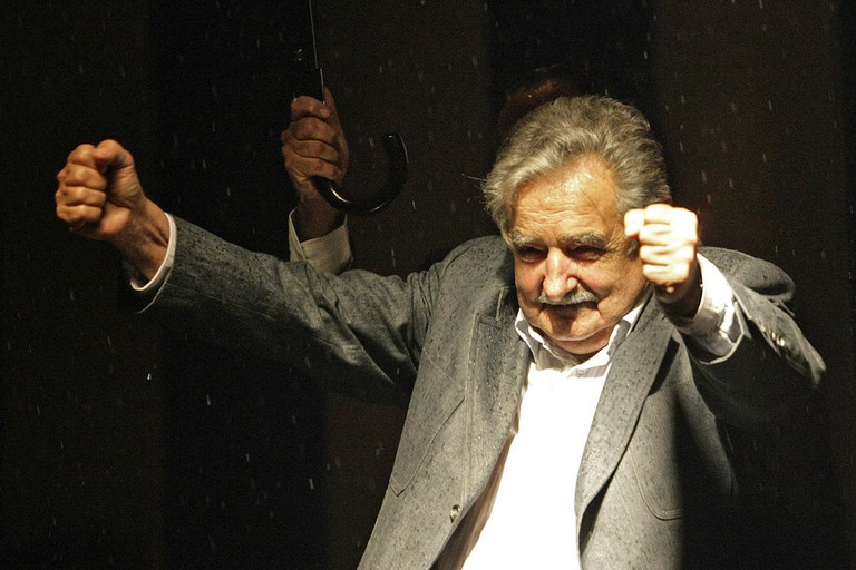 Uruguay's president-elect Jose Mujica celebrates winning the presidential run-off election in Montevideo
