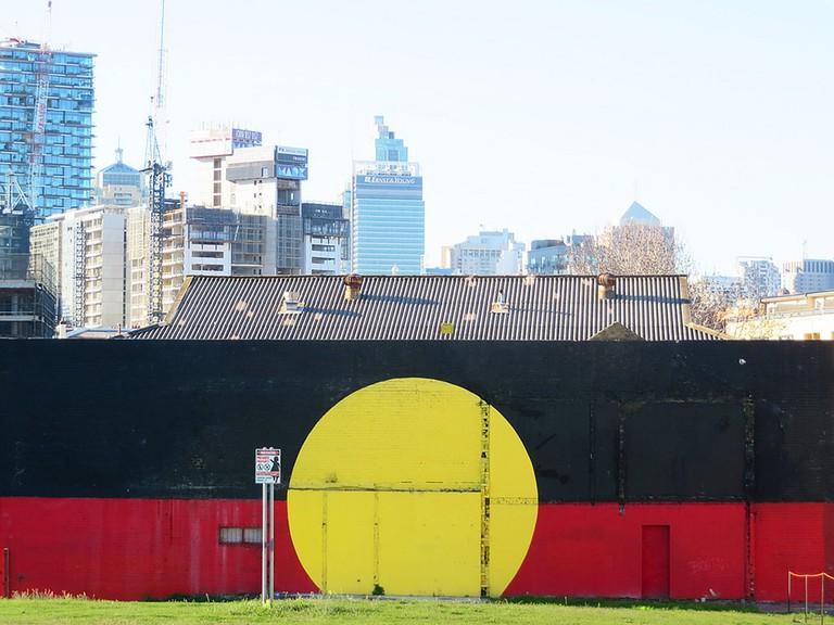 Aboriginal flag mural in Redfern © Newtown graffiti:Flickr