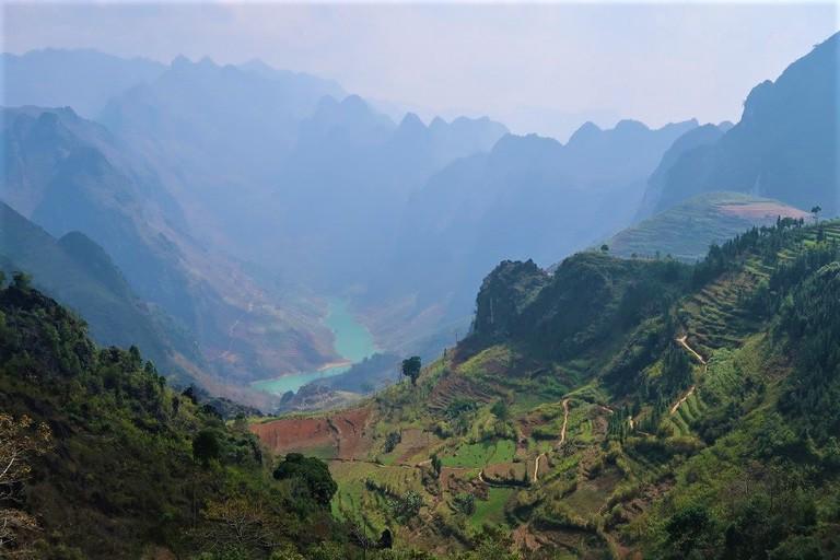 Cartoonishly beautiful rice terraces shine through the midday haze