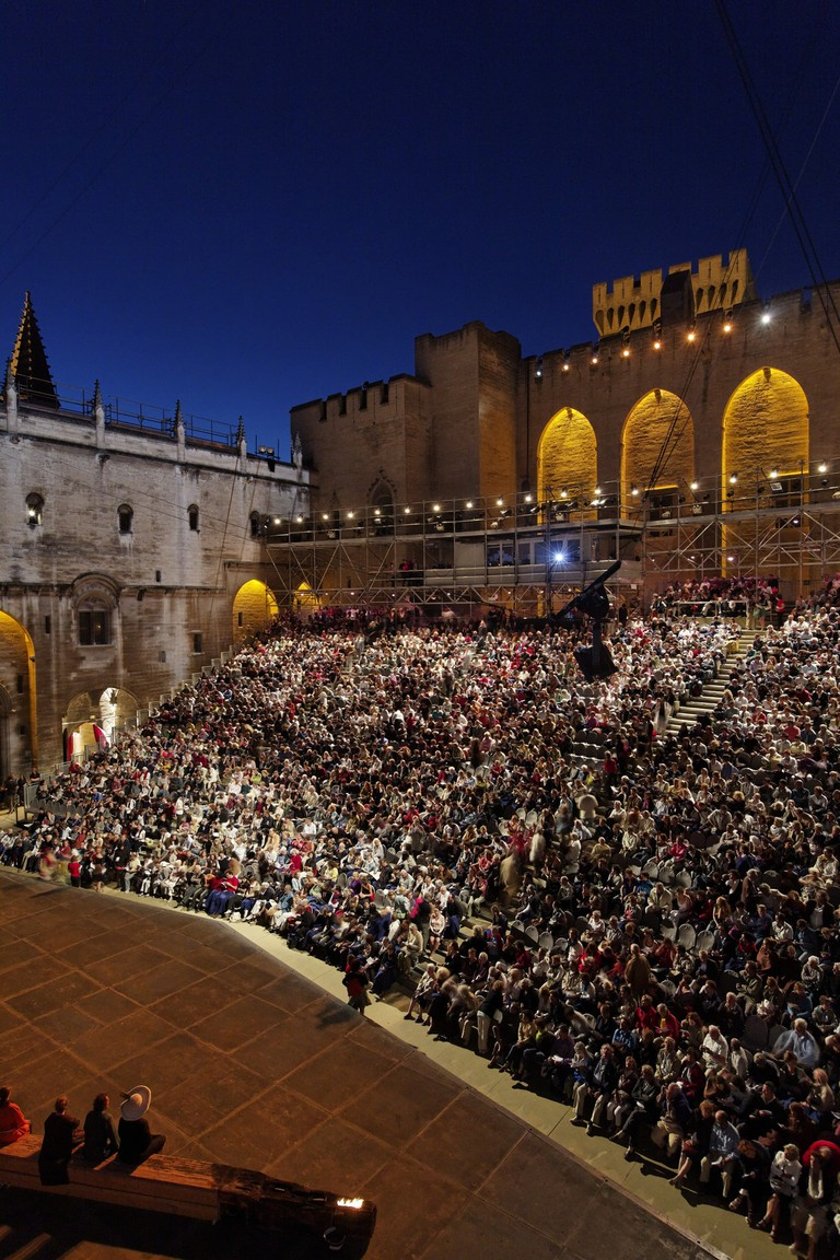 The courtyard of the immense Palais des Papes during the Avignon festival  © Courtesy of Avignon Festival / Christophe Raynaud de Lage