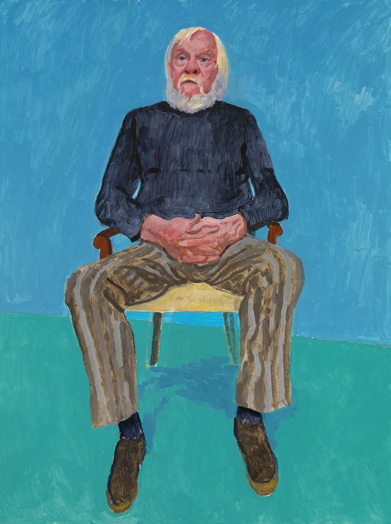 Portrait of American artist John Baldessari sitting against a blue background by David Hockney