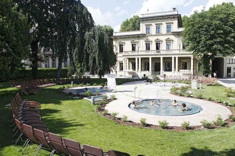 Relax in the peaceful garden at QC TermeTorino | Courtesy QC TermeTorino