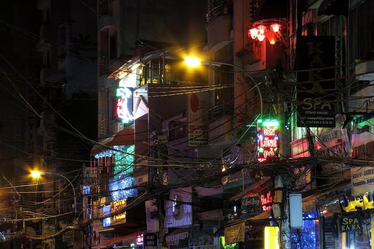 Neon lights hang over Bui Vien