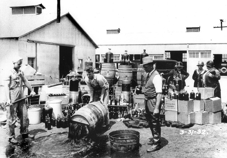 Orange_County_Sheriff's_deputies_dumping_illegal_booze,_Santa_Ana,_3-31-1932