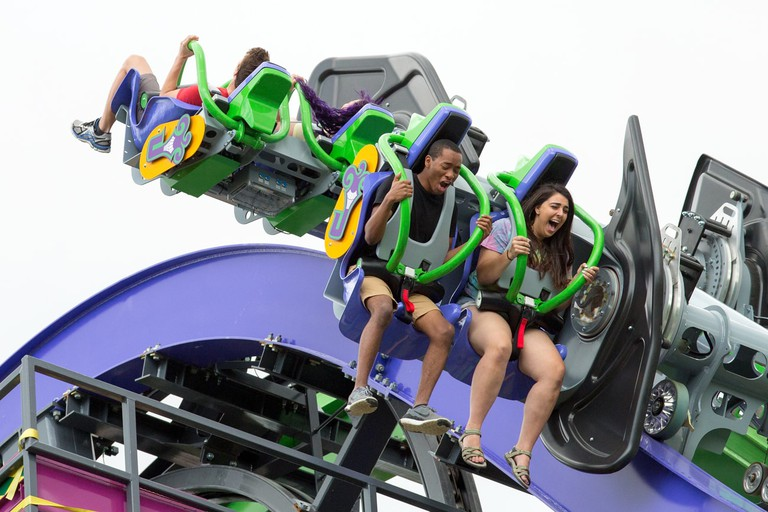 Visitors enjoying The Joker at Six Flags Over Texas
