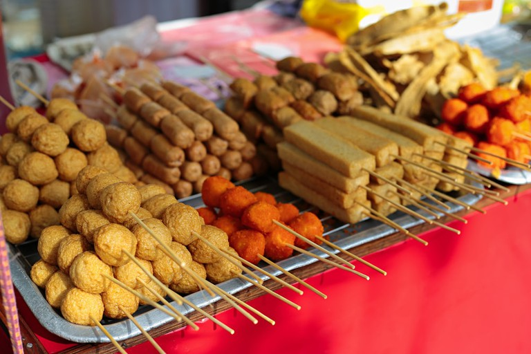 Quick snacks on sticks are easily available in Petaling Street | © Calvin Chan/Shutterstock