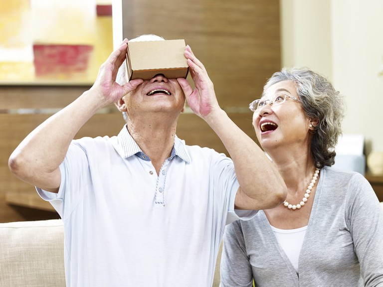 Senior couple experiencing new technology by trying a VR device | © imtmphoto/Shutterstock