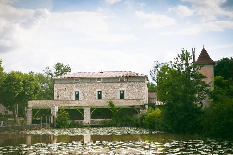 Medieval Brick Water Mill Next to Pond Outside Eymet, France   © Kelsey Hayne/Shutterstock