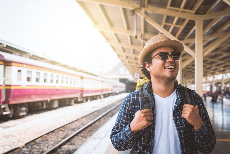 A traveler in a train station