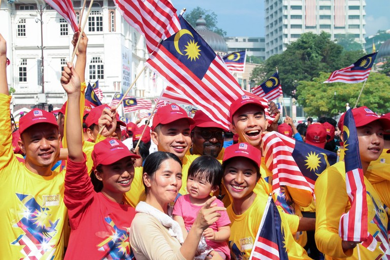 Patriotic volunteers celebrating their country indepence day at the iconic site Merdeka square, Kuala Lumpur, Malaysia | © Calvin Chan/Shutterstock