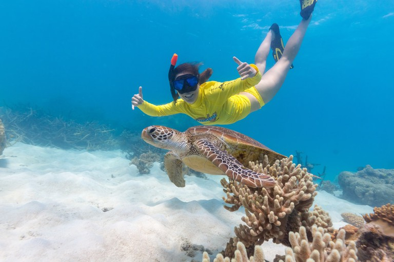 A happy Ocean Safari customer on the Great Barrier Reef