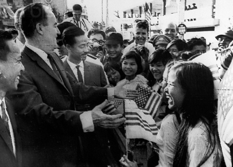 Saigon. Vice-president Hubert Humphrey is greeted by Vietnamese school children during a tour of nine Asian countries. Left: Premier Nguyen Cao Ky of South Vietnam. February 10, 1966.