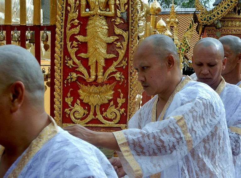 Prospective monks wearing white robes