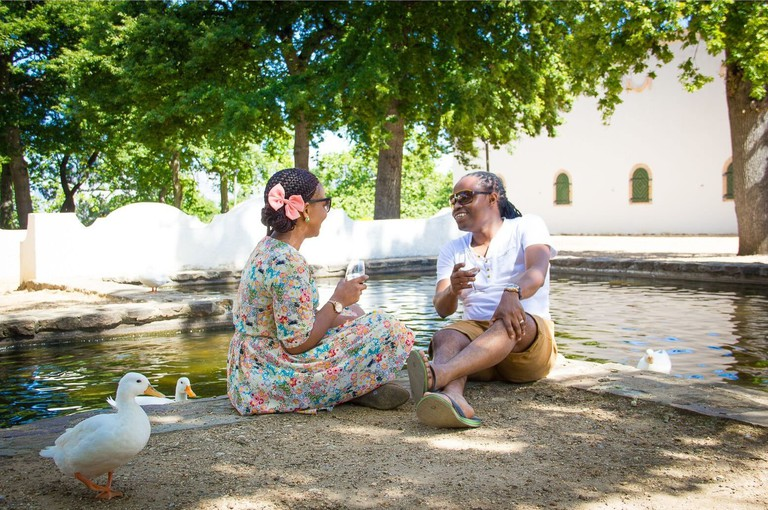 A couple enjoys wine at Groot Constantia