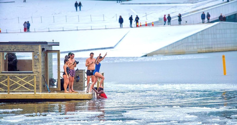 A swim in the freezing waters after a sauna at KOK Oslo, Courtesy of KOK Oslo
