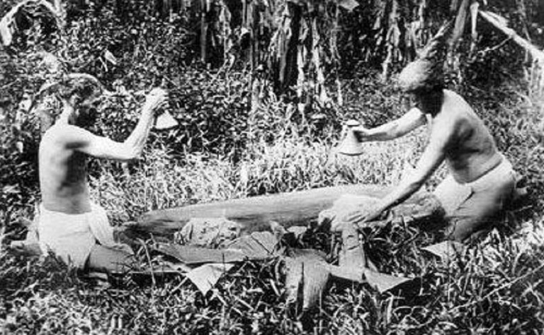Hawaiian_men_pounding_poi,_c._1890