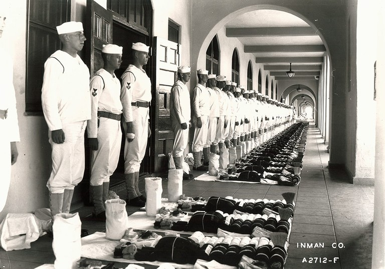 Navy recruits line up for inspection.