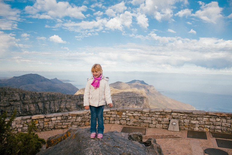 Kid enjoys the view on top of Table Mountain