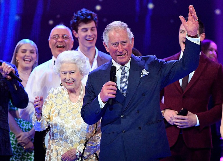 Queen Elizabeth II and Prince Charles surrounded by guests on stage at the Royal Albert Hall in London during a star-studded concert to celebrate the Queen's 92nd birthday