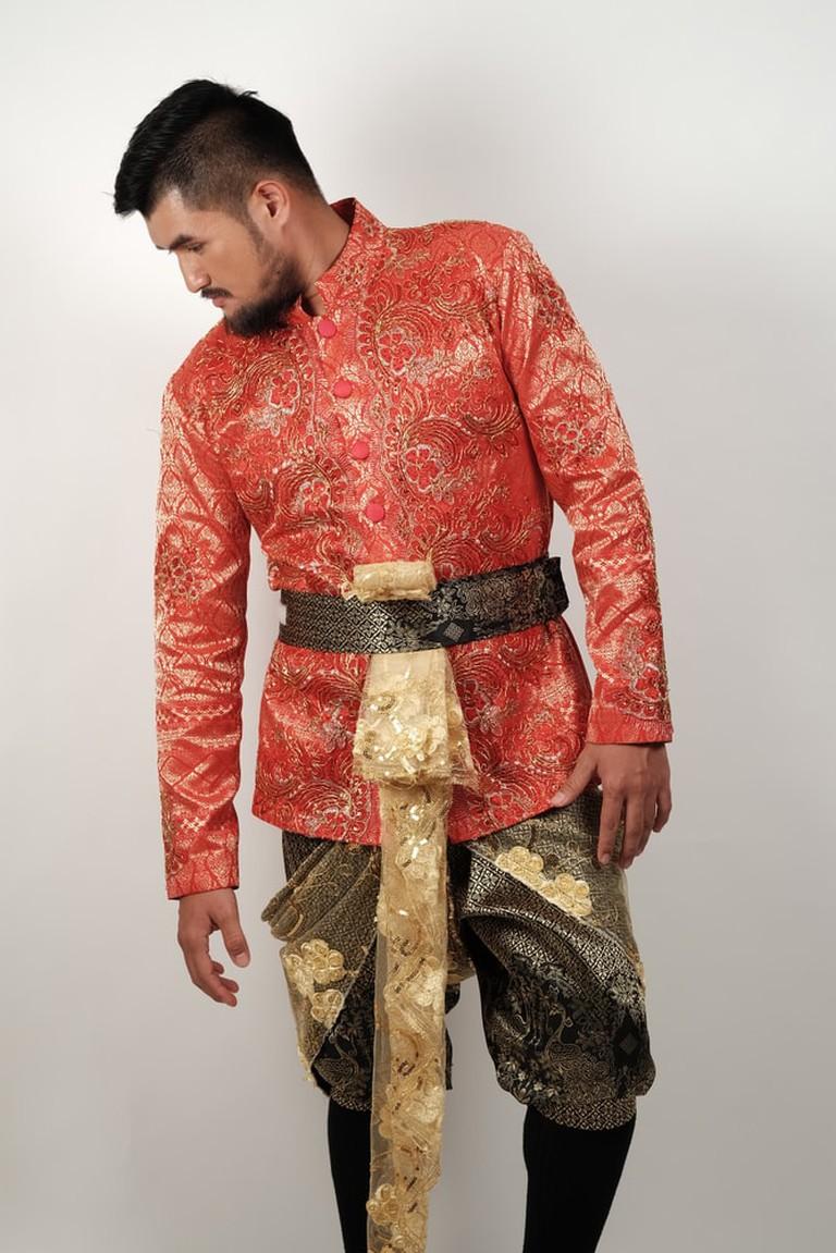 Man wearing typical Thai dress