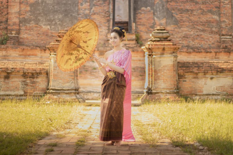 Asia woman wearing traditional Thai dress