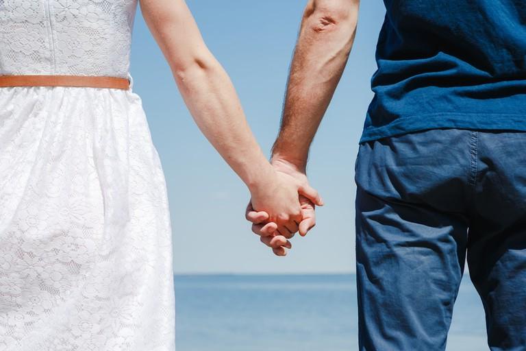 Couple holding hands   © Olga Danylenko/Shutterstock