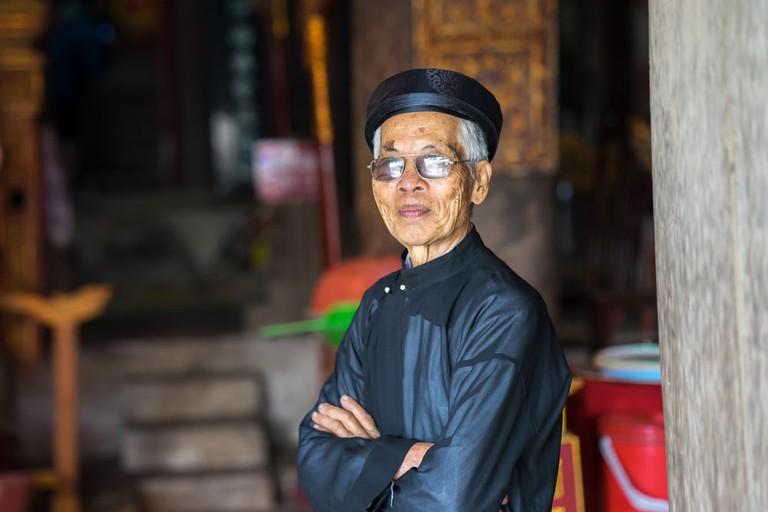 Old man with ancient traditional long dress Ao Dai