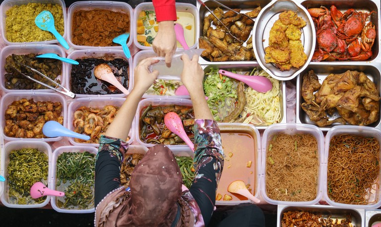 Malaysian home cooked dishes sold at street market stall in Kota Kinabalu Sabah