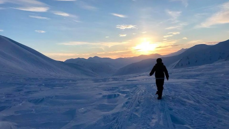 Walking towards the light in Longyearbyen, Courtesy of Visit Svalbard