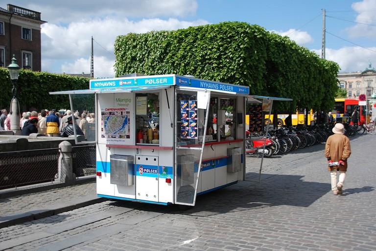 1200px-Danish_hot_dog_stand_in_Copenhagen