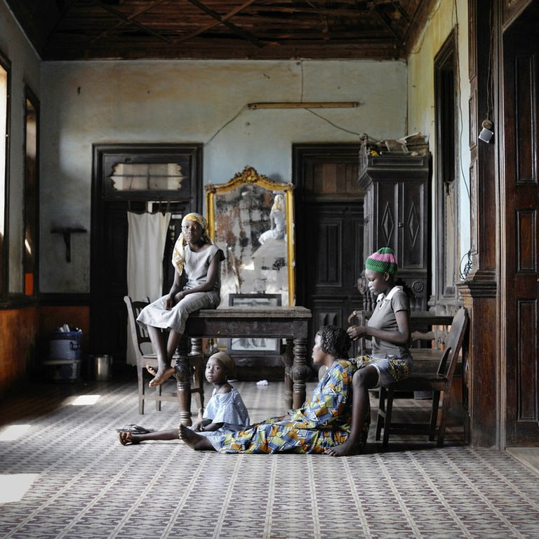 Conforte with Godonou family in the living room of their house, Porto Novo.