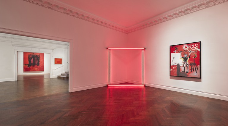 Installation of 'Reds' at Mnuchin Gallery, featuring Dan Flavin's 'untitled (to Sabine and Holger)' (1966–1971) and Jean-Michel Basquiat's 'The Ring' (1981) in the foreground