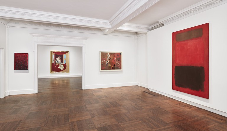 Installation view of 'Reds,' with Mark Rothko's 'Browns and Blacks in Reds' (1957) on the far right