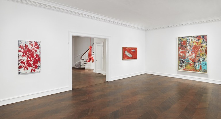 Installation view of 'Reds,' with Willem de Kooning's 'Composition' (1955) on the far right and Louise Bourgeois's 'Red Night' (1946–1948) to its left