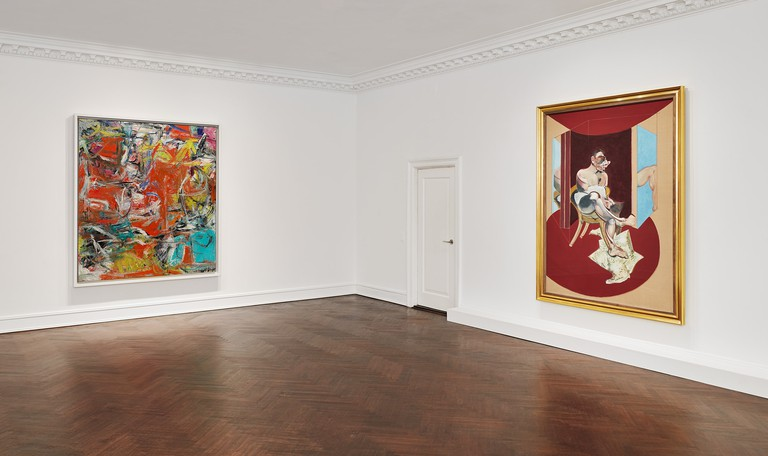 Installation view of 'Reds,' with Francis Bacon's 'Study of George Dyer' (1971) on the right and Willem de Kooning's 'Composition' (1955) on the left