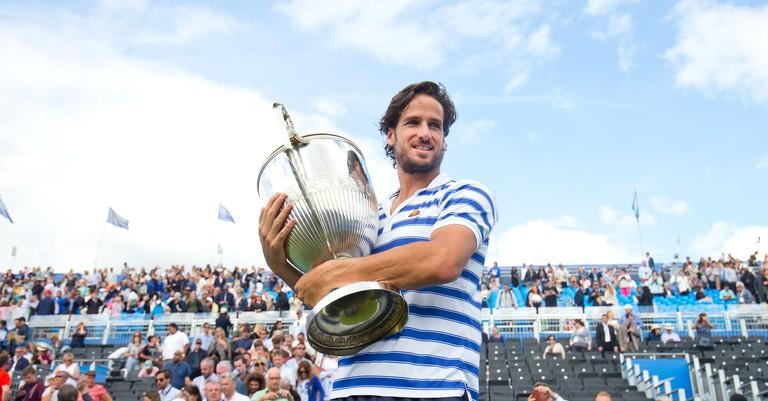 Feliciano Lopez celebrates winning the Aegon Championship Tennis singles title beating Marin Cilic